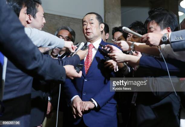 Japan's Justice Minister Katsutoshi Kaneda meets with reporters on June 15 after the parliament enacted contentious legislation to criminalize the...