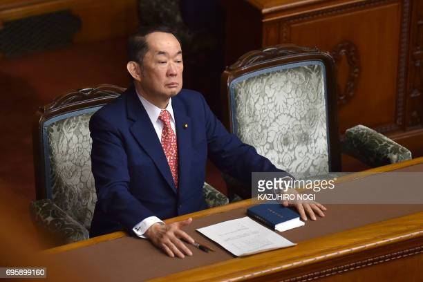 Japan's Justice Minister Katsutoshi Kaneda waits for a vote on a censure motion against him by lawmakers during an upper house plenary session of...