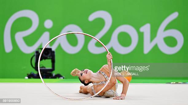 Japan's Kaho Minagawa competes in the individual allaround qualifying event of the Rhythmic Gymnastics at the Olympic Arena during the Rio 2016...
