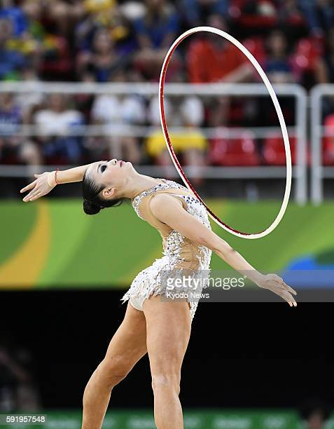 Japan's Kaho Minagawa performs with hoop during the rhythmic gymnastics individual allaround qualification at the Rio de Janeiro Olympics on Aug 19...