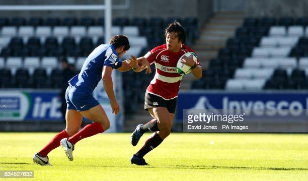 Japan's Kanzo Nakahama is tackled by France's Mathieu Belie during the Invesco Perpetual Junior Rugby World Cup match at Liberty Stadium Swansea