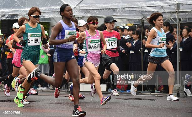 Japan's Kaori Yoshida and Yoko Shibui compete with foreign guest runners in the Saitama International Marathon in Saitama city on November 15 2015...