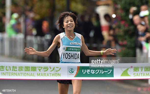 Japan's Kaori Yoshida crosses the fiinish line in the Saitama International Marathon in Saitama city on November 15 2015 AFP PHOTO / KAZUHIRO NOGI