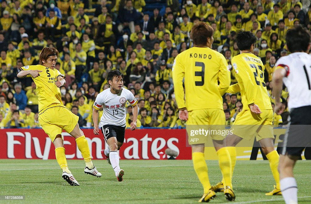 Japan's Kashiwa Reysol defender Tatsuya Masushima (L) kicks the ball into the goal against China's Guizhou Renhe during the AFC Champions League group H match in Kashiwa in Chiba prefecture, suburban Tokyo on April 23, 2013. Kashiwa and Guizhou drew the game 1-1.