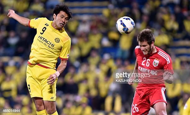 Japan's Kashiwa Reysol forward Masato Kudo heads the ball past Vietnam's Binh Duong forward David Vrankovic during their AFC Champions League Group...