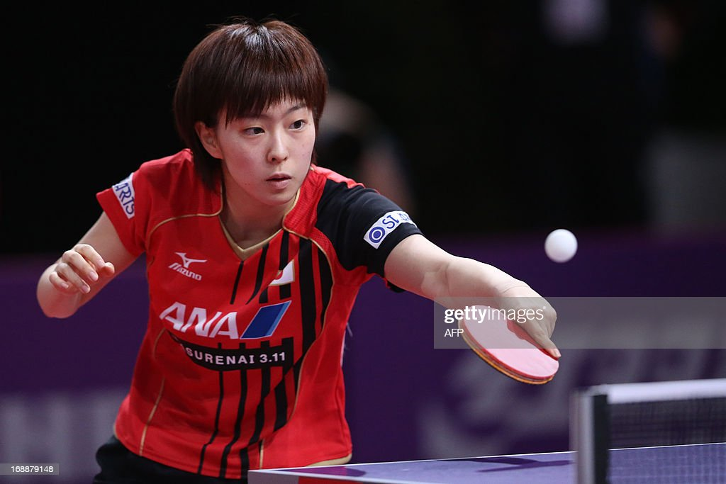 Japan's Kasumi Ishikawa competes during the third round of the Women's Singles of the World Table Tennis Championships in Paris on May 16, 2013. Japan's Kasumi Ishikawa plays against North Korea's Sun Ri Myong. AFP PHOTO / THOMAS SAMSON