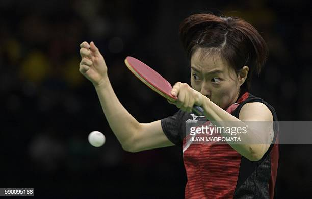 Japan's Kasumi Ishikawa hits a shot in the women's team bronze medal table tennis match against Singapore at the Riocentro venue during the Rio 2016...