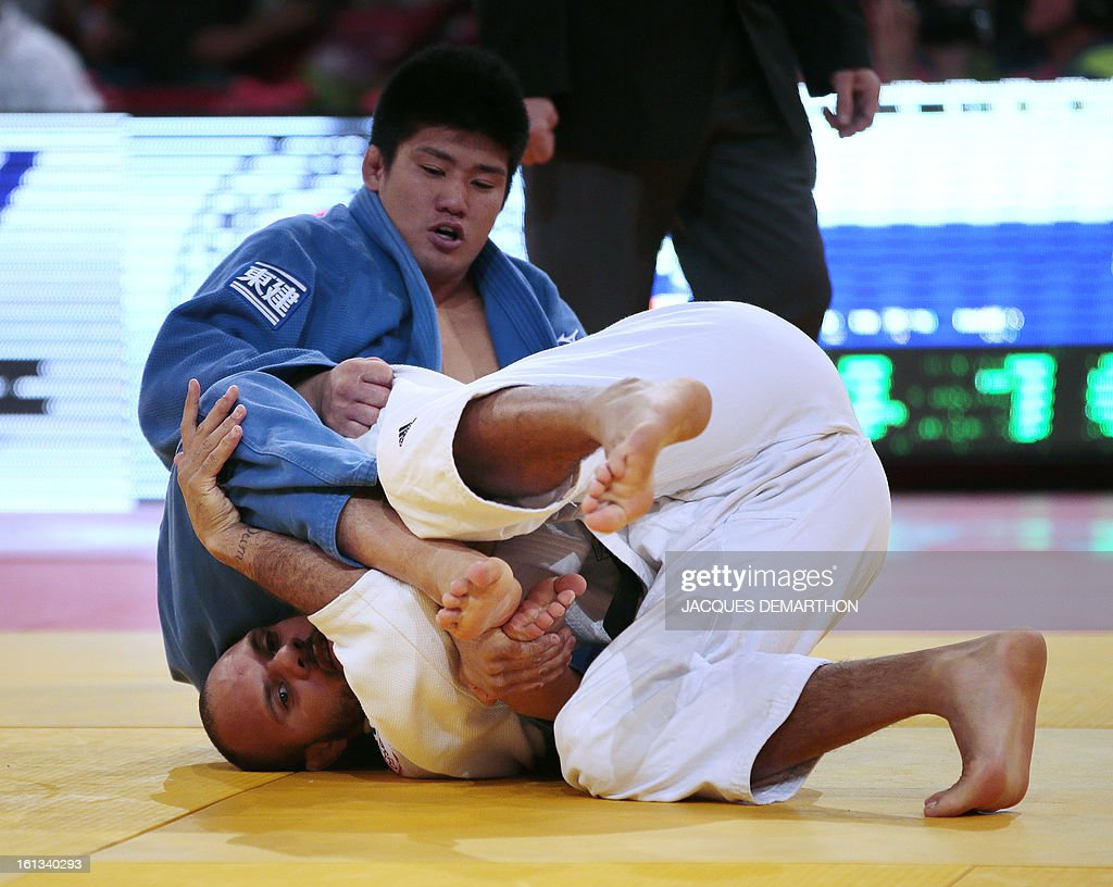 Japan's Kato Hirotaka (Up) competes against France's Ludovic Gobert on February 10, 2013 in the men's 90kg category qualifying fight during the Paris International Judo tournament, part of the Grand Slam, at the Palais Omnisports de Paris-Bercy (POPB).