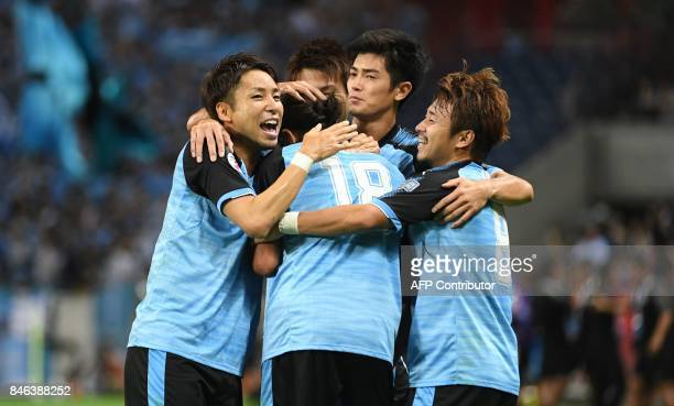 Japan's Kawasaki Frontale defender Elsinho celebrates his goal with teammates during the AFC Champions League quarterfinal football match between...