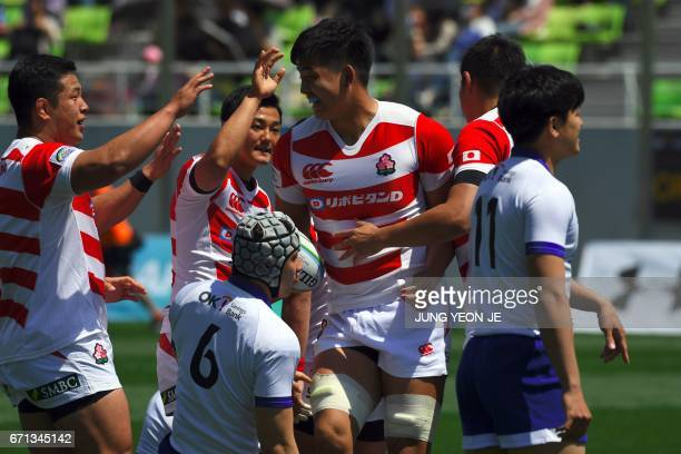 Japan's Kazuhiko Usami celebrates with teammates after scoring a try against South Korea during their Asian Rugby Championship match at the Namdong...
