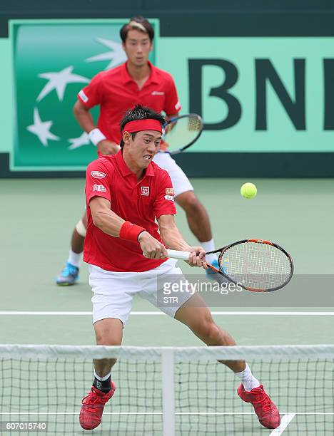 Japan's Kei Nishikori and Yuichi Sugita play against Ukraine during their doubles tennis match of the Davis Cup World Group playoff in Osaka on...