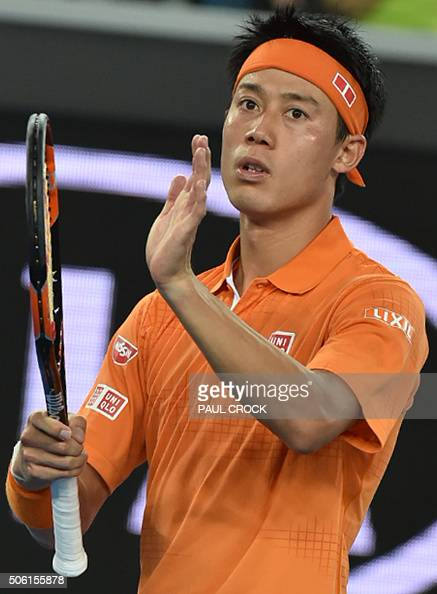 Japan's Kei Nishikori celebrates after victory in his men's singles match against Spain's Guillermo GarciaLopez on day five of the 2016 Australian...