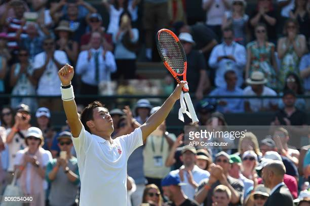 Japan's Kei Nishikori celebrates beating Ukraine's Sergiy Stakhovsky during their men's singles second round match on the third day of the 2017...