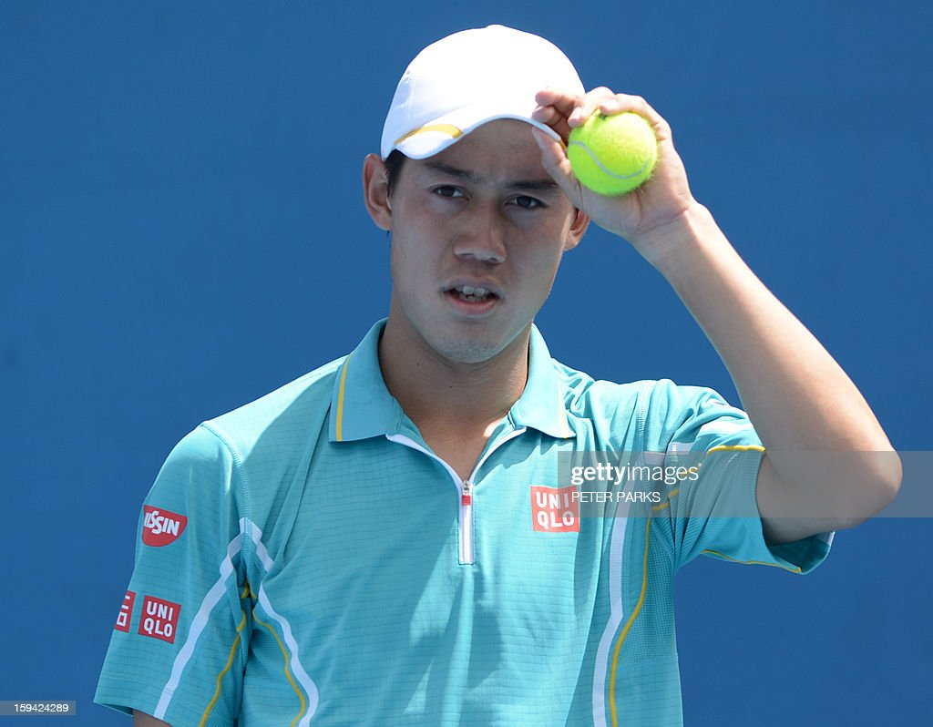 Japan's Kei Nishikori gestures after playing a stroke to Romania's Victor Hanescu during their men's singles match on the first day of the Australian Open tennis tournament in Melbourne on January 14, 2013.
