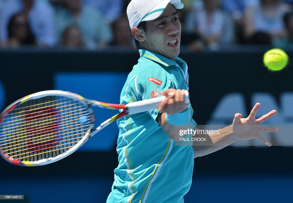 Japan's Kei Nishikori hits a return against Spain's David Ferrer during their men's singles match on day seven of the Australian Open tennis tournament in Melbourne on January 20, 2013.