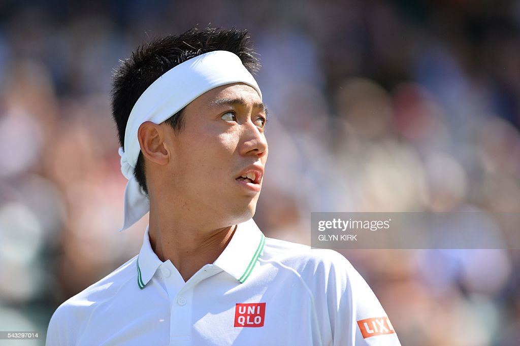 Japan's Kei Nishikori looks on as he plays against Australia's Sam Groth during their men's singles first round match on the first day of the 2016 Wimbledon Championships at The All England Lawn Tennis Club in Wimbledon, southwest London, on June 27, 2016. / AFP / GLYN