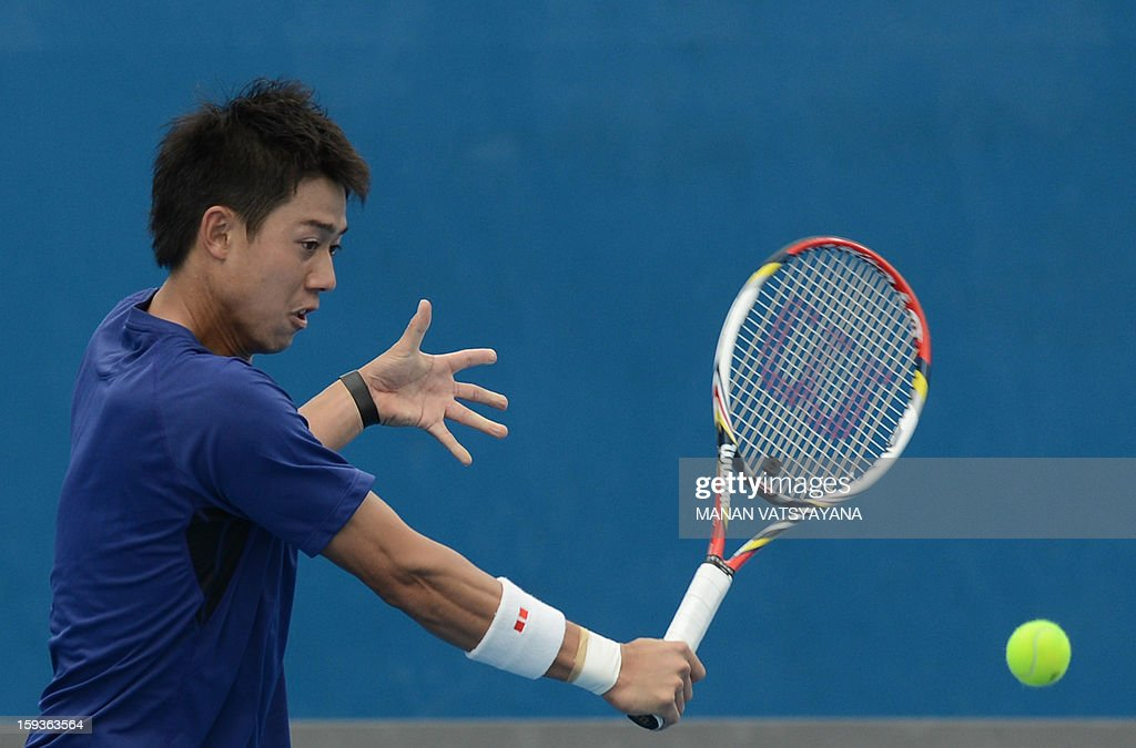 Japan's Kei Nishikori plays a return during a practice session ahead of the 2013 Australian Open tennis tournament on January 13, 2013.