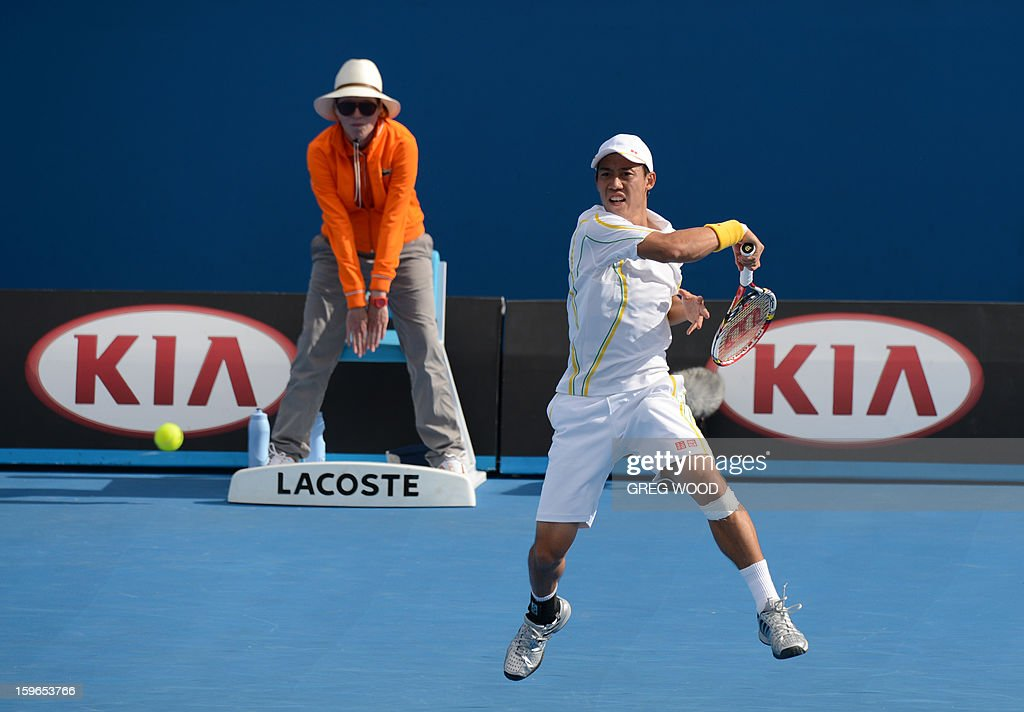 Japan's Kei Nishikori plays a return during his men's singles match against Evgeny Donskoy of Russia on the fifth day of the Australian Open tennis tournament in Melbourne on January 18, 2013.