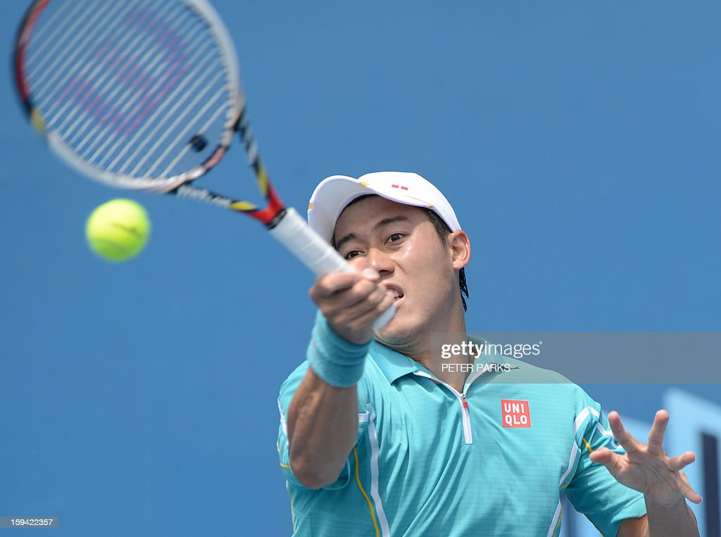 Japan's Kei Nishikori plays a return to Romania's Victor Hanescu during their men's singles match on the first day of the Australian Open tennis tournament in Melbourne on January 14, 2013. AFP PHOTO/PETER PARKS IMAGE STRICTLY RESTRICTED TO EDITORIAL USE - STRICTLY NO COMMERCIAL USE