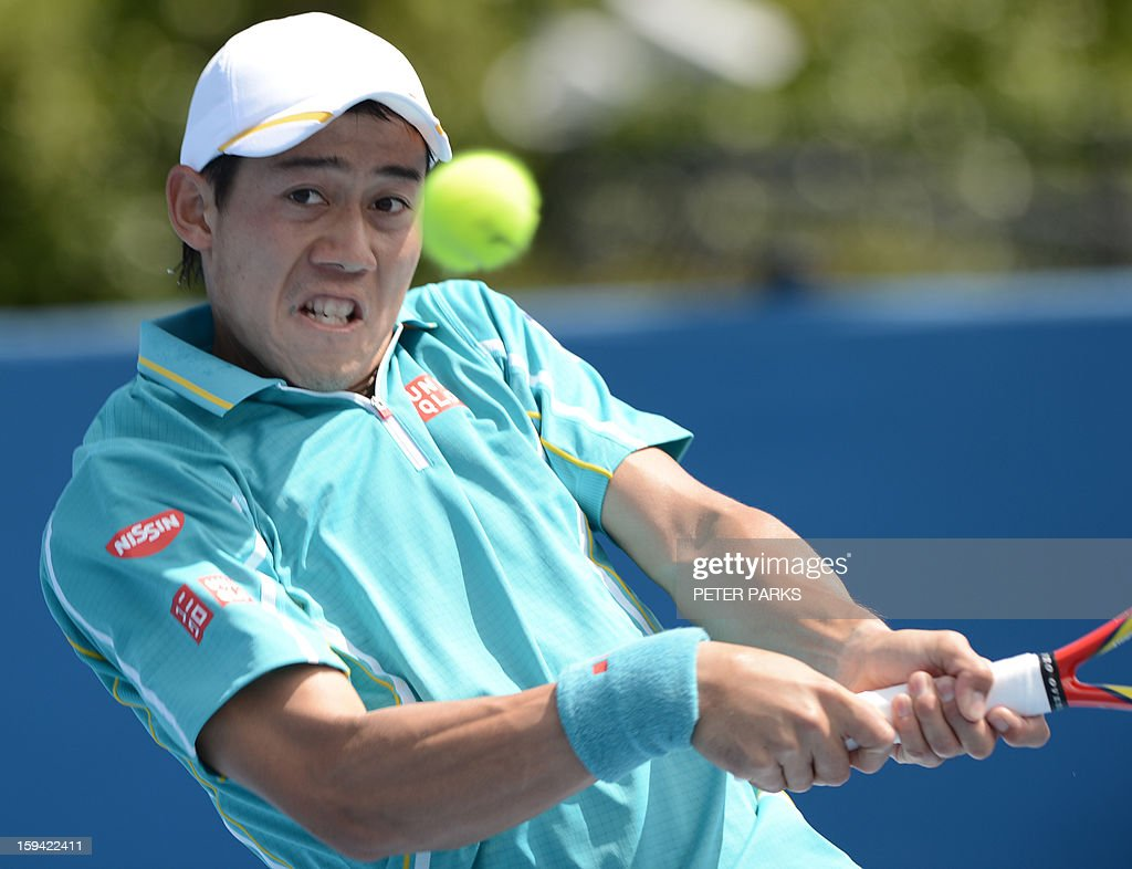 Japan's Kei Nishikori plays a return to Romania's Victor Hanescu during their men's singles match on the first day of the Australian Open tennis tournament in Melbourne on January 14, 2013.