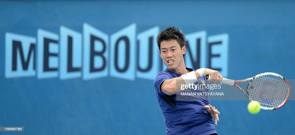 Japan's Kei Nishikori plays a stroke during a practice session ahead of the 2013 Australian Open tennis tournament on January 13, 2013.