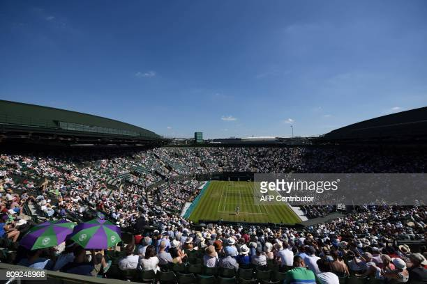 Japan's Kei Nishikori plays against Ukraine's Sergiy Stakhovsky during their men's singles second round match on the third day of the 2017 Wimbledon...