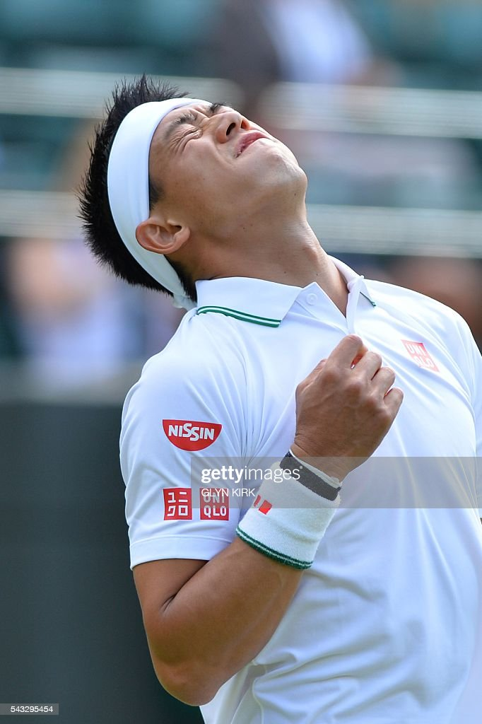 Japan's Kei Nishikori reacts after a point against Australia's Sam Groth during their men's singles first round match on the first day of the 2016 Wimbledon Championships at The All England Lawn Tennis Club in Wimbledon, southwest London, on June 27, 2016. / AFP / GLYN