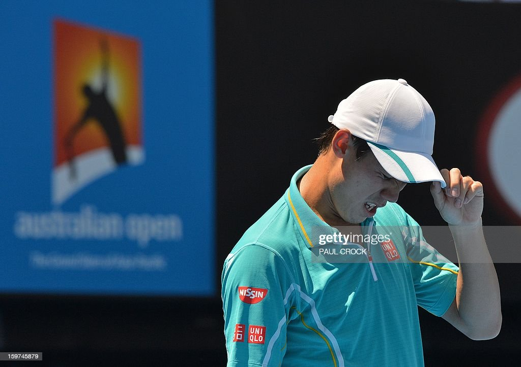 Japan's Kei Nishikori reacts after a point against Spain's David Ferrer during their men's singles match on day seven of the Australian Open tennis tournament in Melbourne on January 20, 2013. AFP PHOTO / PAUL CROCK IMAGE STRICTLY RESTRICTED TO EDITORIAL USE - STRICTLY NO COMMERCIAL USE