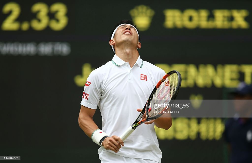 Japan's Kei Nishikori reacts after losing a point to France's Julien Benneteau during their men's singles second round match on the fourth day of the 2016 Wimbledon Championships at The All England Lawn Tennis Club in Wimbledon, southwest London, on June 30, 2016. / AFP / JUSTIN