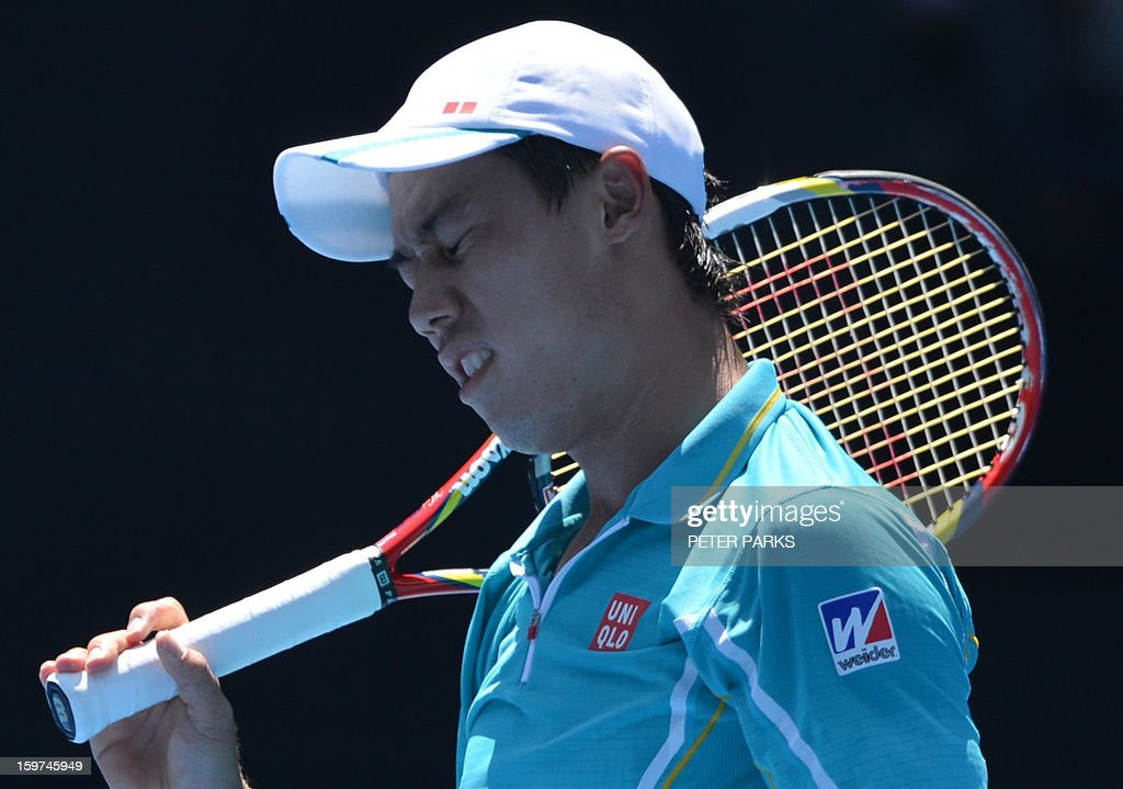 Japan's Kei Nishikori reacts during his men's singles match against Spain's David Ferrer on the seventh day of the Australian Open tennis tournament in Melbourne on January 20, 2013.