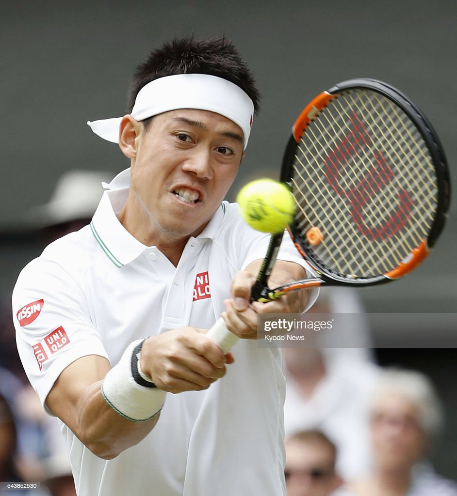 Japan's <a gi-track='captionPersonalityLinkClicked' href=/galleries/search?phrase=Kei+Nishikori&family=editorial&specificpeople=4432498 ng-click='$event.stopPropagation()'>Kei Nishikori</a> returns a shot against Julien Benneteau of France in a men's singles second-round match at the Wimbledon championships in London on June 30, 2016.