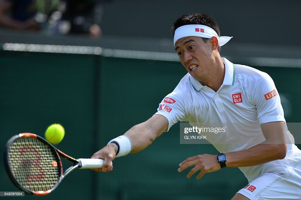 Japan's Kei Nishikori returns against Australia's Sam Groth during their men's singles first round match on the first day of the 2016 Wimbledon Championships at The All England Lawn Tennis Club in Wimbledon, southwest London, on June 27, 2016. / AFP / GLYN