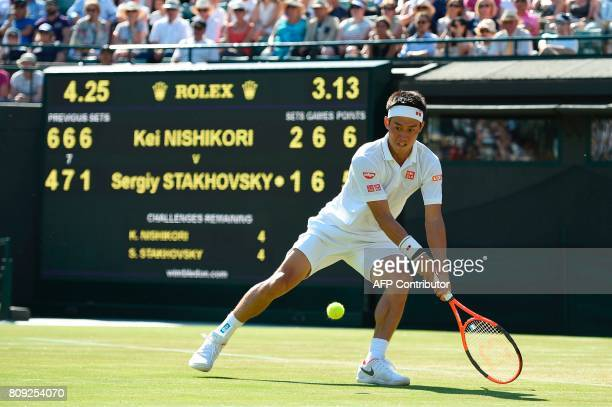 Japan's Kei Nishikori returns against Ukraine's Sergiy Stakhovsky during their men's singles second round match on the third day of the 2017...