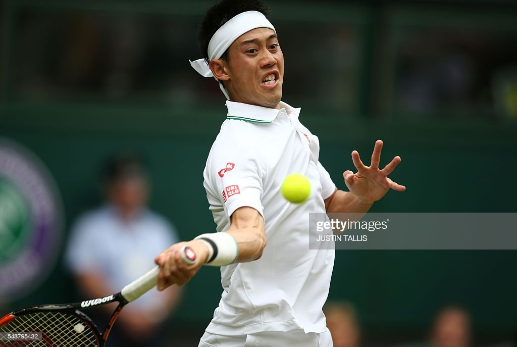 Japan's Kei Nishikori returns to France's Julien Benneteau during their men's singles second round match on the fourth day of the 2016 Wimbledon Championships at The All England Lawn Tennis Club in Wimbledon, southwest London, on June 30, 2016. / AFP / JUSTIN