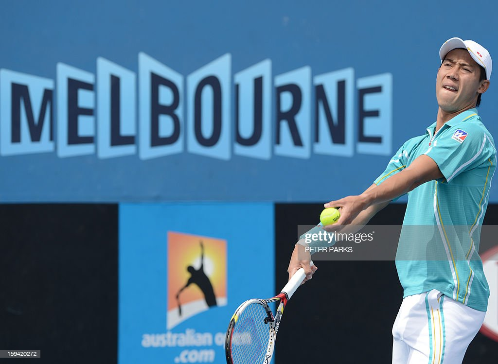 Japan's Kei Nishikori serves to Romania's Victor Hanescu during their men's singles match on the first day of the Australian Open tennis tournament in Melbourne on January 14, 2013. AFP PHOTO/PETER PARKS IMAGE STRICTLY RESTRICTED TO EDITORIAL USE - STRICTLY NO COMMERCIAL USE