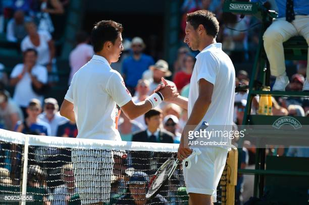 Japan's Kei Nishikori shake hands with Ukraine's Sergiy Stakhovsky after Nishikori won their men's singles second round match on the third day of the...
