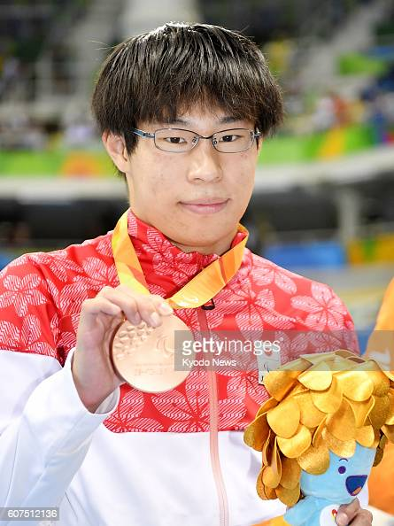 Japan's Keichi Nakajima poses with his bronze medal for the men's 200meter individual medley in the SM14 class at the Paralympics in Rio de Janeiro...