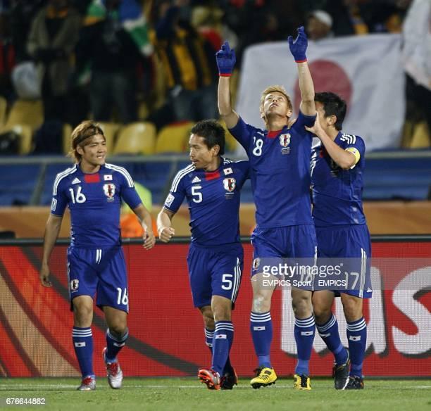 Japan's Keisuke Honda celebrates with team mates Makoto Hasebe Yuto Nagatomo and Yoshito Okubo after he scores the opening goal of the game
