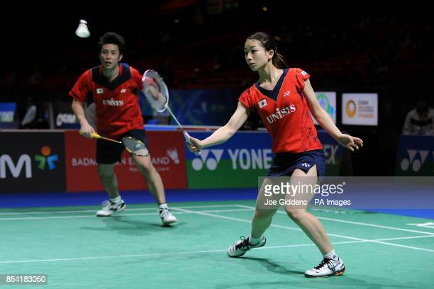 Japan's Kenichi Hayakawa and Misaki Matsutomo during day two of the 2013 Yonex All England Badminton Championships at the National Indoor Arena...