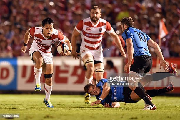 Japan's Kenki Fukuoka runs the ball against Uruguay during their friendly rugby union match at Prince Chichibu Memorial Rugby Ground in Tokyo on...