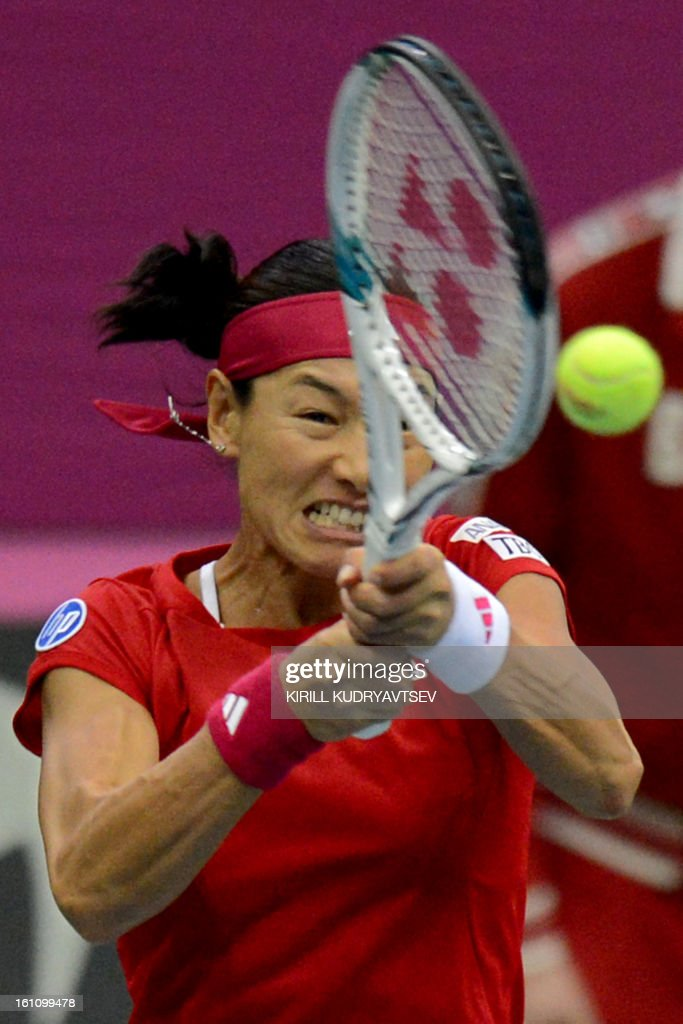 Japan's Kimiko Date-Krumm returns a ball to Russia's Maria Kirilenko during the International Tennis Federation Fed Cup quarterfinal match between Russia and Japan in Moscow on February 9, 2013.