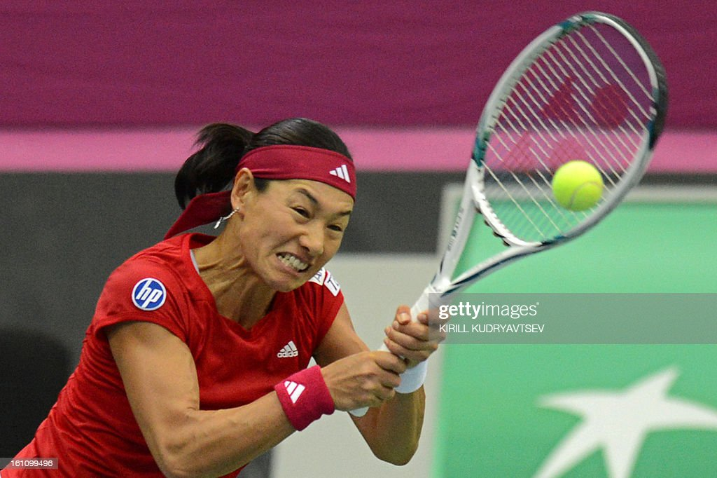 Japan's Kimiko Date-Krumm returns a ball to Russia's Maria Kirilenko during the International Tennis Federation Fed Cup quarterfinal match between Russia and Japan in Moscow on February 9, 2013. AFP PHOTO/ KIRILL KUDRYAVTSEV