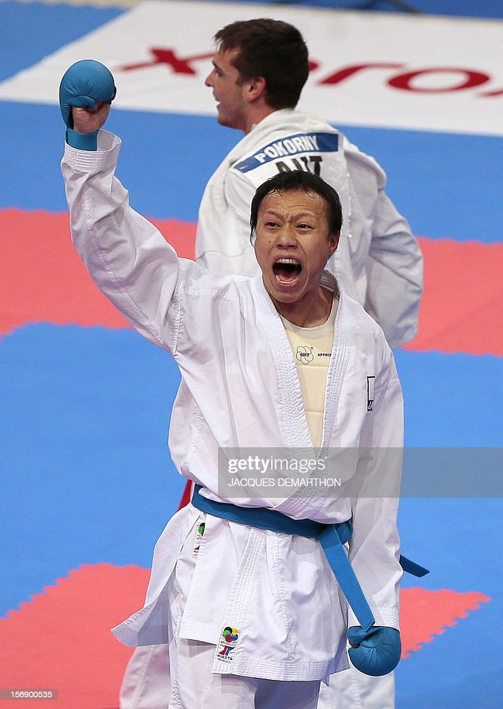 Japan's Ko Matsuhisa (front) celebrates his victory over Austria's Stefan Pokorny during their men's bronze medal bout in the under 75 Kg category at the Karate world championships on November 24, 2012 in Paris. Matsuhisa won the bout.