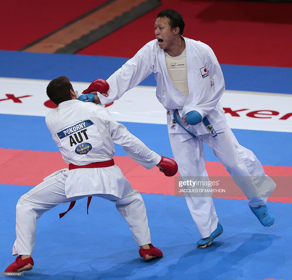 Japan's Ko Matsuhisa (R) fights against Austria's Stefan Pokorny (L) during their men's bronze medal bout in the under 75 Kg category at the Karate world championships on November 24, 2012 in Paris. Matsuhisa won the bout. AFP PHOTO/JACQUES DEMARTHON