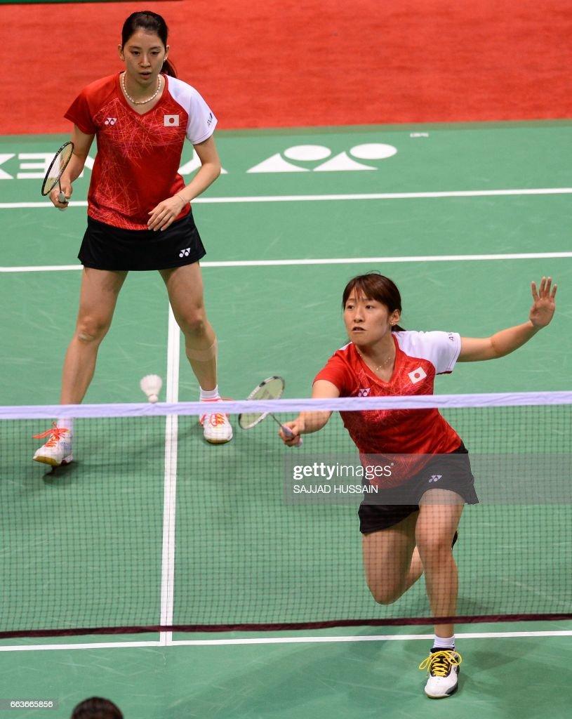 Japan s Koharu Yonemoto L and Shiho Tanaka R play a return to