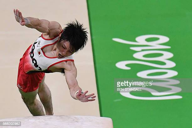 TOPSHOT Japan's Kohei Uchimura competes in the vault event of the men's individual allaround final of the Artistic Gymnastics at the Olympic Arena...