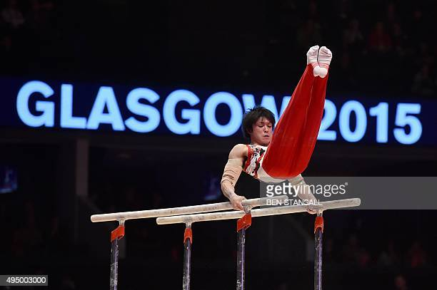 Japan's Kohei Uchimura performs on the parallel bars during the Men's AllAround final during the 2015 World Gymnastics Championship in Glasgow...