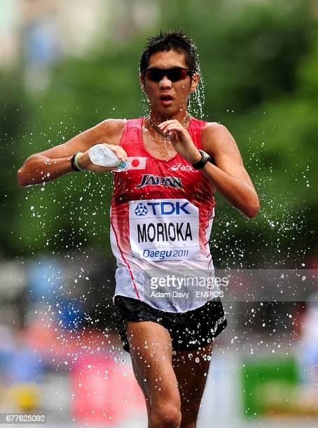 Japan's Koichiro Morioka cools himself down during the Men's 50km Walk