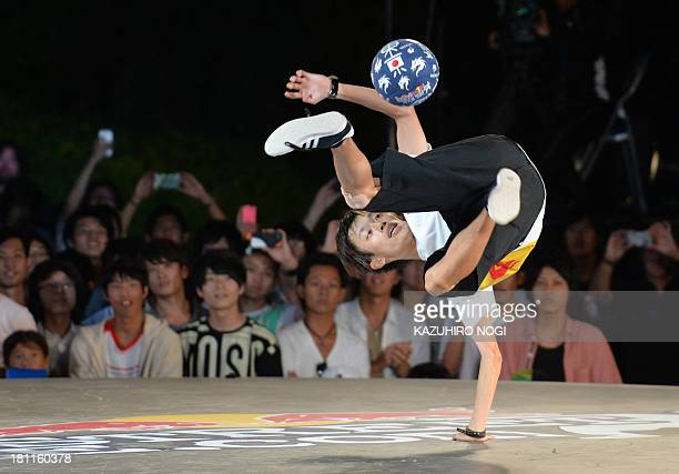 Japan's Kotaro Tokuda 'Tokura' performs during the third place match against Britain's Andrew Henderson 'Andrew' at the world final of the Red Bull...
