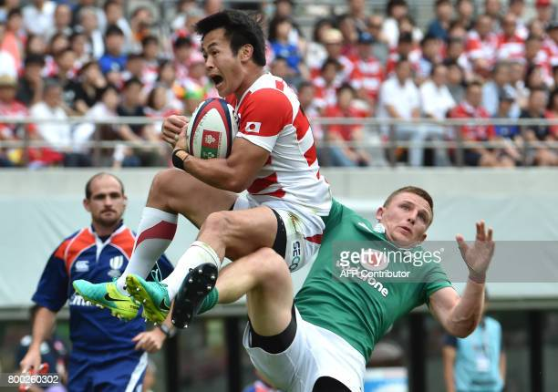 Japan's leftwing Kenki Fukuoka and Ireland's fullback Andrew Conway fight for the ball during their rugby union test match in Tokyo on June 24 2017 /...